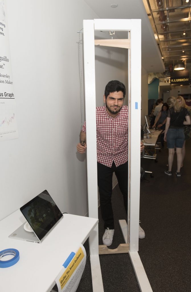 Student interacting with a student project which includes a physical installation at IDM showcase 2018