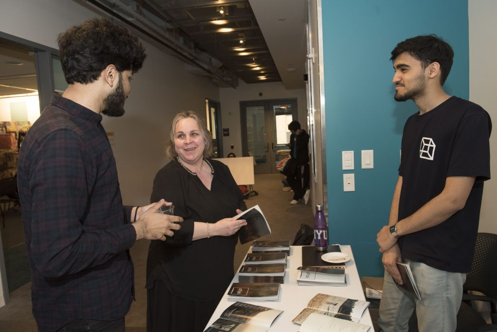 Student discussing their work at IDM showcase 2018