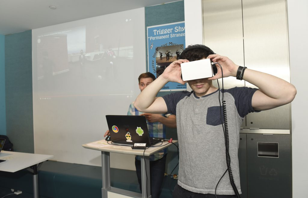 Person interacting with a VR based student project at IDM showcase 2017