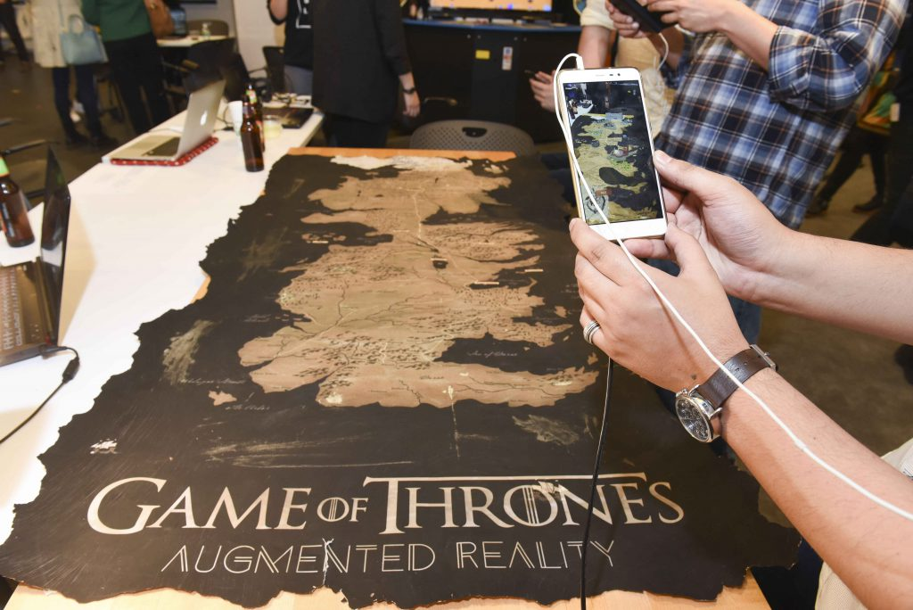 person interacting with mobile AR game of thrones themed project at IDM showcase 2017