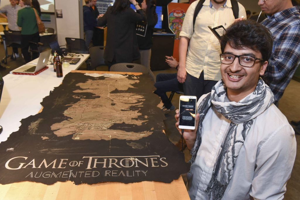 student presenting their mobile AR game of thrones themed project at IDM showcase 2017