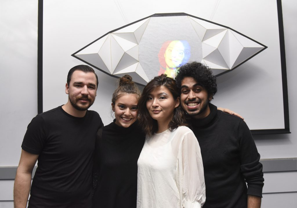 Students standing with a project which includes an eye shaped physical installation at IDM showcase 2017