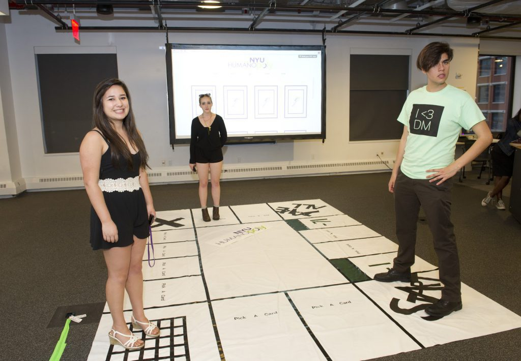 Student Project which is a large board game on the floor at IDM 2015 showcase