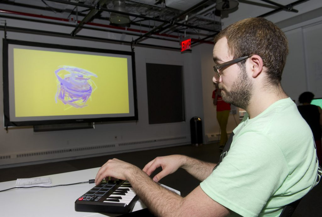 Student project with a screen projection and musical keyboard at IDM 2015 showcase